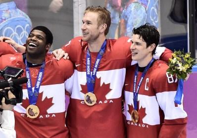 Subban, Cater et Crosby, médaille au cou et souriants