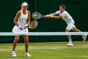 Daniel Nestor et Kristina Mladenovic durant les demi-finales du double mixte à Wimbledon en 2014
