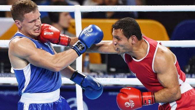 Samir El Mais (droite-rouge) a décroché l'or en boxe.)