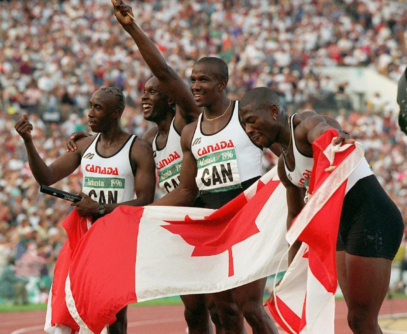 The Canadian men's 4X100 metre relay team celebrate after winning the gold medal at the Summer Olympic Games in Atlanta, Saturday, August 3, 1996. Seen from left to right are Robert Esmie, Bruny Surin, Donovan Bailey and Glenroy Gilbert. (AP Photo/DenisPaquin)