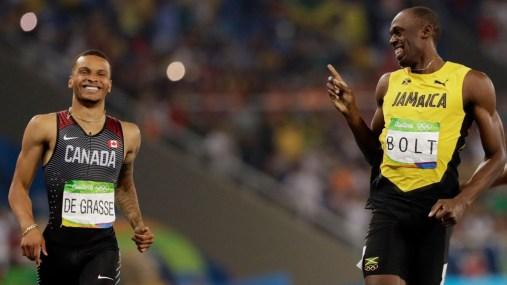 Andre De Grasse et Usain Bolt pendant la demi-finale du 200 m aux Jeux olympiques de Rio, le 17 août 2016.
