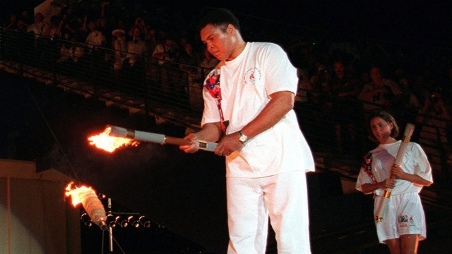 Muhammad Ali lights the Olympic flame in Atlanta on July 19, 2016.  Muhammad Ali lights the Olympic flame in Atlanta on July 19, 2016.