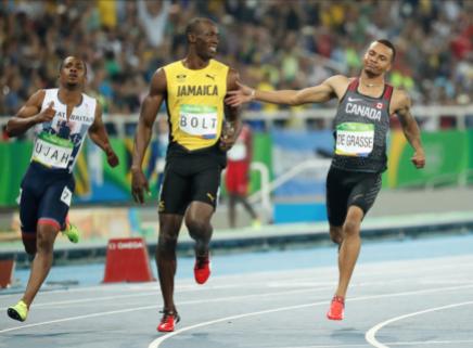 Usain Bolt et Andre De Grasse lors de la demi-finale du 100 m aux Jeux olympiques, le 14 août 2016