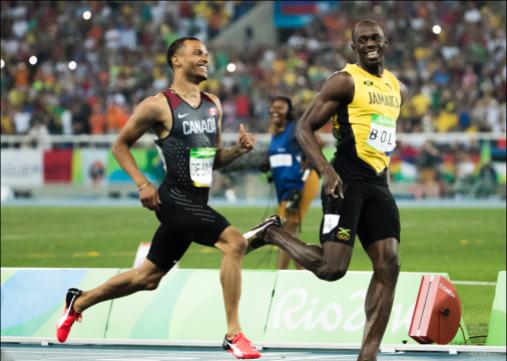 Andre De Grasse et Usain Bolt rigolent en courant