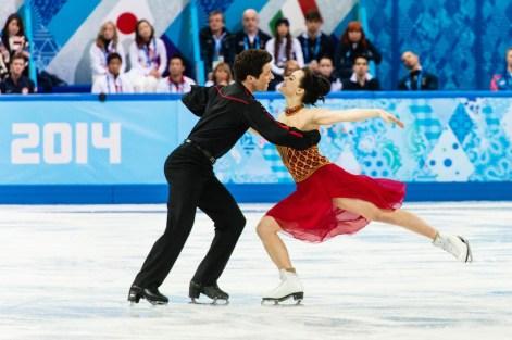 Tessa Virtue et Scott Moir lors de la compétition par équipes aux Jeux olympiques de Sotchi, le 9 février 2014. THE CANADIAN PRESS/Winston Chow