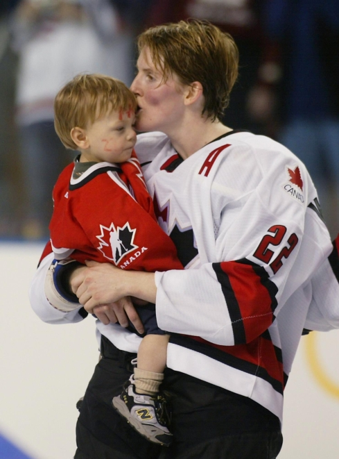 Olympic gold medalist Hayley Wickerheiser, of Shaunavon, Sask., kisses her son Noah Pachina following Canada's 3-2 victory against USA in women's hockey tournament at the Olympic Winter Games in Salt Lake City, Utah, Thursday Feb. 21, 2002. (CP PHOTO/Tom Hanson)
