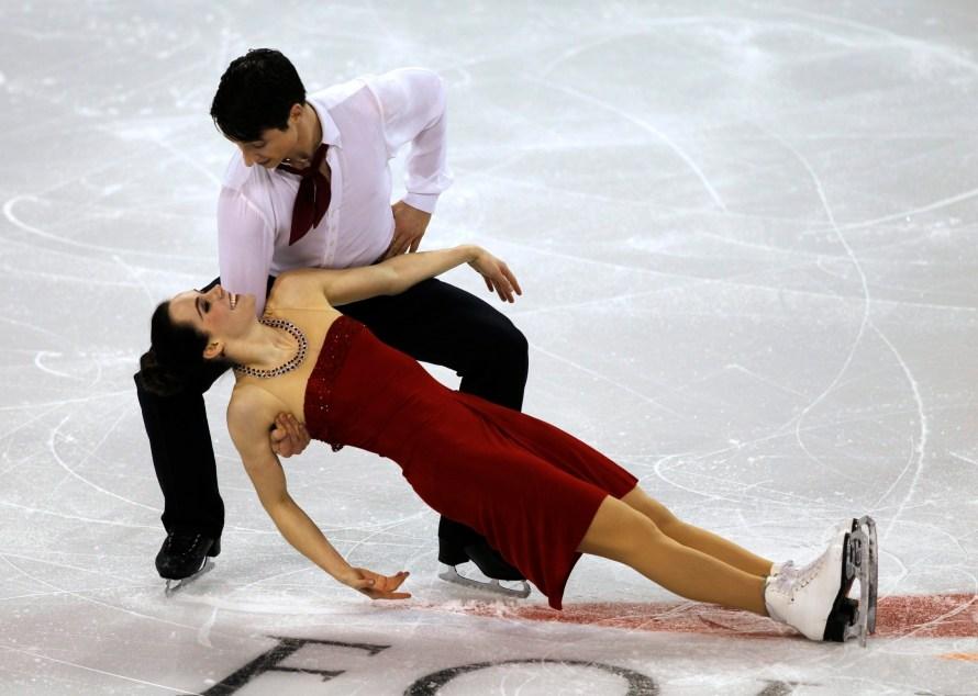 Tessa Virtue et Scott Moir lors de leur programme libre aux Championnats des quatre continents de patinage artistique à Colorado Springs, au Colorado, le dimanche 12 février 2012. (AP Photo/David Zalubowski)