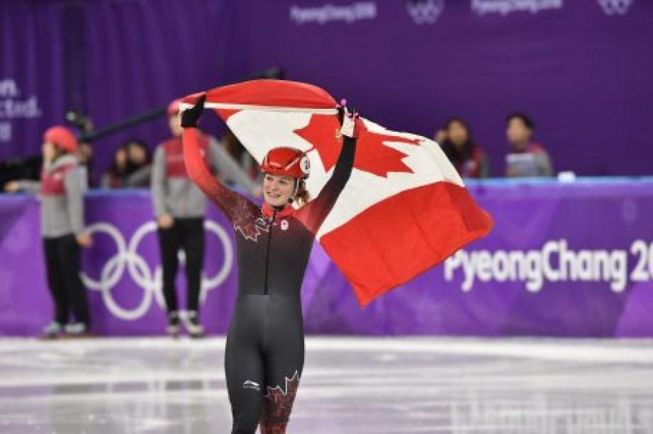 Kim Boutin célèbre après avoir décroché le bronze au 1000 m. (COC/Vincent Ethier)