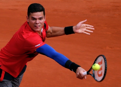 Milos Raonic et sa manche bleue lors des Internationaux de France le 3 juin 2014.(AP Photo/Michel Euler)