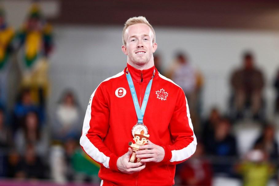 Cory Paterson avec sa médaille de bronze du concours multiple individuel aux Jeux panaméricains de Lima, au Pérou, le 29 juillet 2019. Photo : Claudio Cruz / Lima 2019