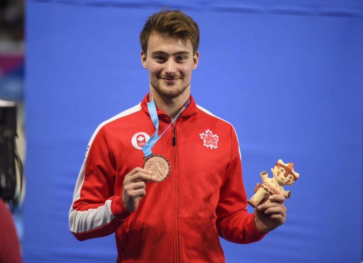 Philippe Gagné et sa médaille de bronze du 3 m masculin