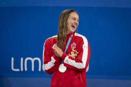 Danielle Hanus remporte l'argent au 100 m dos aux Jeux panaméricains de Lima, au Pérou, le 8 août 2019. Photo : Christopher Morris/COC