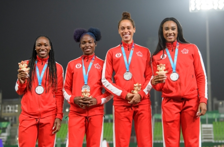 LIMA, Peru - Khamica Bingham, Crystal Emmanuel, Ashlan Best et Leya Buchanan ont remporté l'argent au relais 4 x 100 m aux Jeux panaméricains de Lima, au Pérou, le 10 août 2019. Photo : Christopher Morris/COC