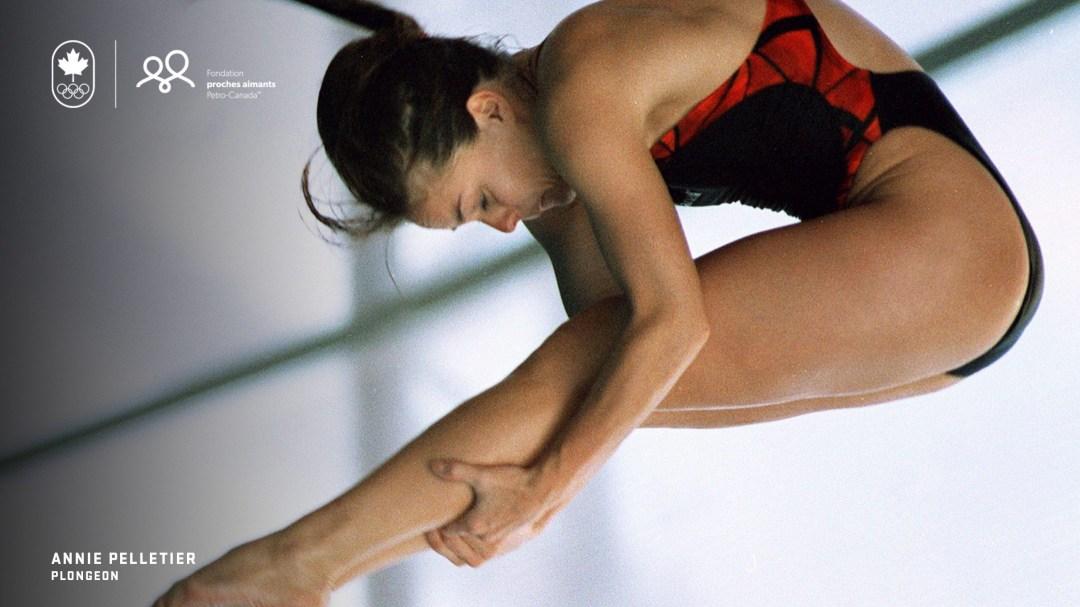 Annie Pelletier plonge en position carpée.
